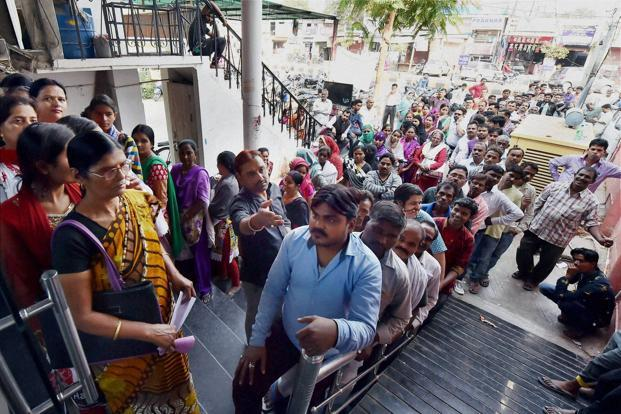 Villagers have to trek to a bank branch to change their cash, which means losing out on crucial days of labour. Photo: PTI