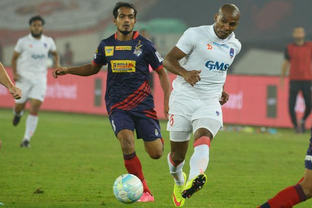 Delhi Dynamos midfielder Florent Johan Malouda (right) vies for the ball with Atletico de Kolkata midfielder Jewel Raja Shaikh during an ISL match. Photo: AFP