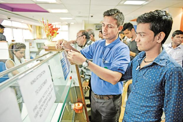 A customer gets an indelible ink mark on his finger at a bank branch in Kolkata on Wednesday. Photo: Indranil Bhoumik/Mint