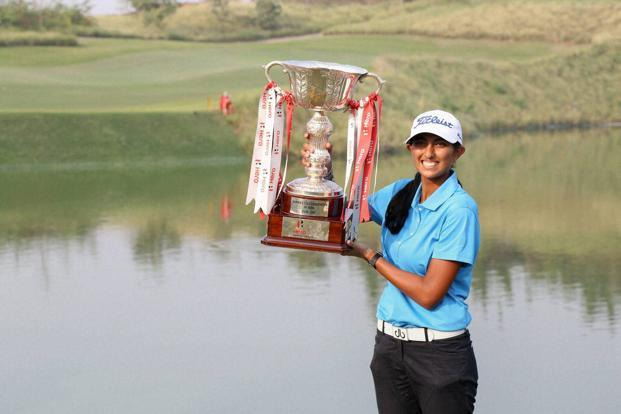Aditi Ashok with the Women's Indian Open trophy.  Photo: PTI