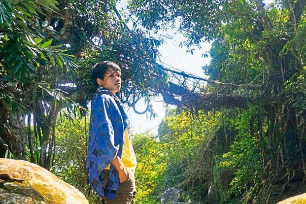 A Khasi teenager at the site of the under-construction bridge in Rimai. Photo: Shamik Bag