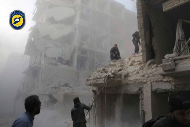 This photo provided by the Syrian Civil Defense White Helmets, which has been authenticated based on its contents and other AP reporting, shows Syrian citizens inspect damage buildings after airstrikes hit the Seif al-Dawleh neighborhood in Aleppo, Syria, on Saturday, November 19.