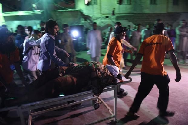 A file photo of bodies of victims at a mortuary in Karachi earlier this month, following a bombing at a Sufi shrine. At least 52 people died and more than 100 others were injured in the bomb blast. Photo: AFP