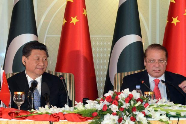 A file photo of Chinese President Xi Jinping (left) with Pakistani Prime Minister Nawaz Sharif. Photo: AFP