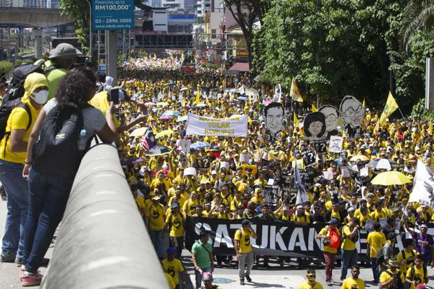 The mood among those gathered was festive, with drums and vuvuzelas heard along with speeches, songs and chants by participants calling for a clean Malaysia and people power. Photo: AP