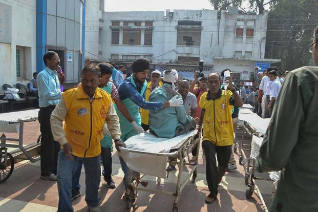 An injured passenger of the Patna-Indore express train is rushed to a hospital in Kanpur on Sunday. AFP