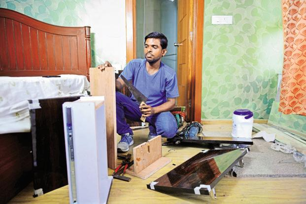 Carpenter Umesh Sharma is registered with UrbanClap. Photos: Abhijit Bhatlekar/Mint