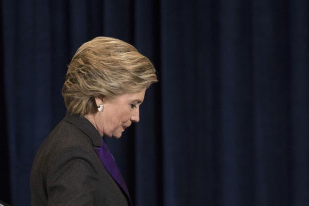 File photo. Democratic presidential candidate Hillary Clinton walks off the stage after speaking in New York on 9 November 2016. Photo: AP