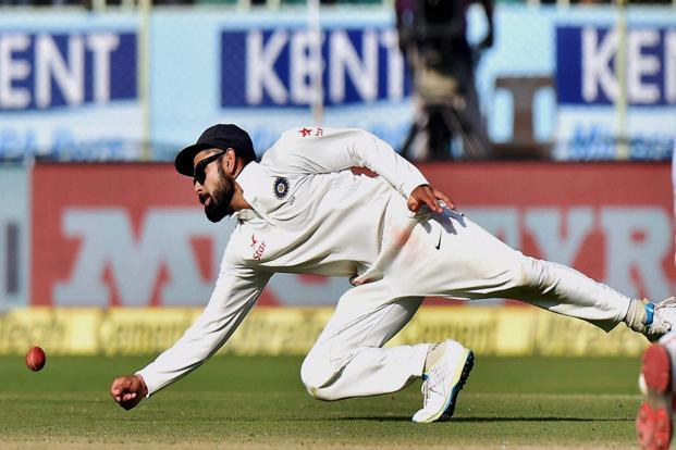 Indian cricket team captain Virat Kohli trying to catch the ball during 4th day of 2nd Test Cricket match in Visakhapatnam on Sunday. Photo: PTI