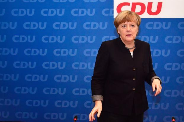 Angela Merkel said that she intends to serve a full, four-year term, 'as long as my health allows it.' Photo: AFP