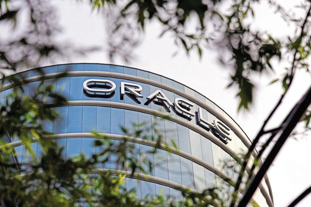 Oracle said Dyn would help its cloud customers improve access and page-load speeds for their websites using Internet performance information. Photo: Bloomberg