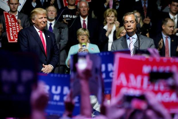 US president-elect Donald Trump (L) and member of the European Parliament Nigel Farage speaks at a campaign rally in US. Photo: Reuters