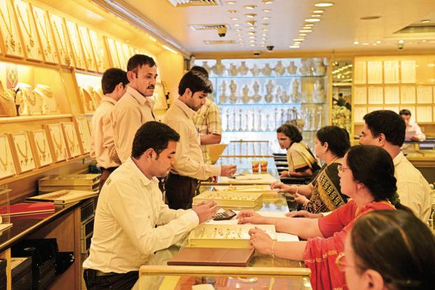 Globally, gold prices fell as the dollar strengthened on growing expectations of a Federal Reserve rate hike in December following positive US economic data. Photo: Hemant Mishra/Mint