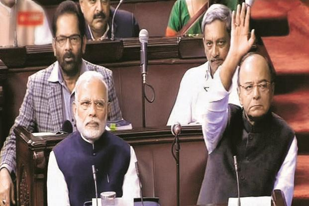 Prime Minister Narendra Modi (left) and finance minister Arun Jaitley in the Rajya Sabha on Thursday. Photo: PTI