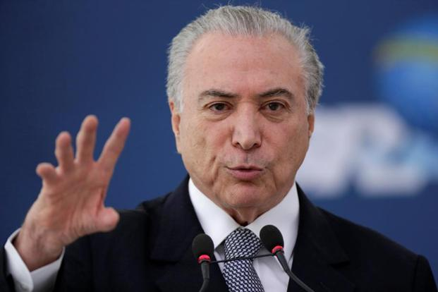 Brazil's real fell the most in the world on Friday on speculation that Michel Temer's possible involvement may derail his government's reform agenda. Photo: Reuters
