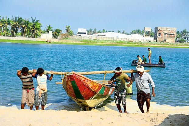 Fishermen at the beach after cyclone Phailin in 2013. Photo: Pradeep Gaur/Mint