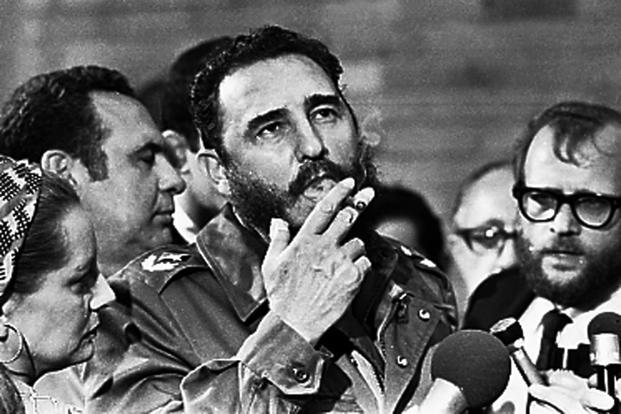 Then Cuban Prime Minister Castro smokes a cigar during interviews with the press during a visit of US senator Charles McGovern, in Havana in this May 1975 picture. Reuters