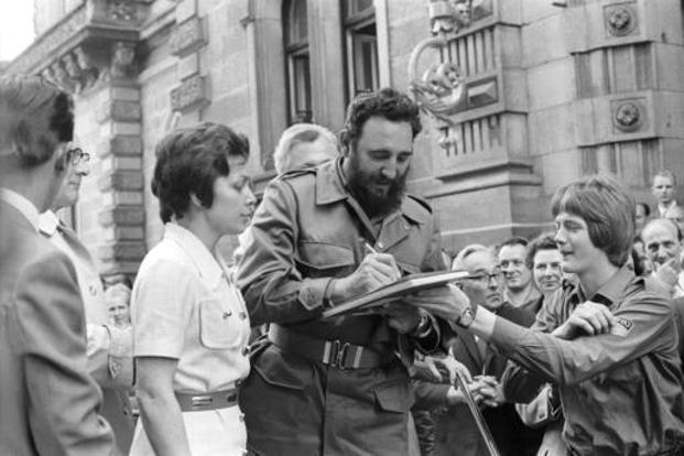 Castro autographs a book in a June 1972 picture during his visit to East Berlin in the former German Democratic Republic. AP