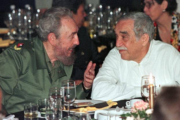 Castro chats with Nobel laureate Gabriel Garcia Marquez (right) during a gala dinner marking the Havana Festival celebrating Cuban cigars, on 4 March 2000. Reuters