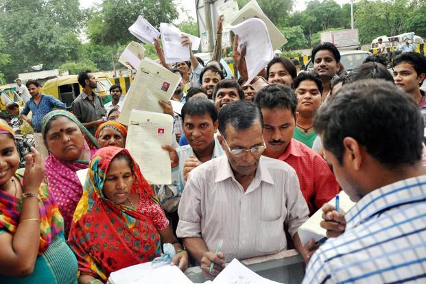 A file photo of people opening accounts under Pradhan Mantri Jan Dhan Yojana in Noida. the 11 weeks prior to 8 November, the highest week-on-week change in account balance was 1.6%. Photo: PTI