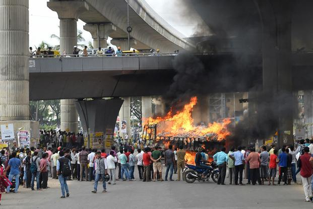 Bus services were affected for many days after the 12 September violence in Bengaluru following the Cauvery verdict. Photo: AFP