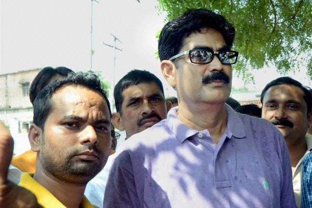 File photo. CBI has agreed to shift Mohammed Shahabuddin (right) to Tihar and conduct a trial in the journalist murder case. Photo: PTI