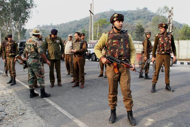 Security personnel take positions during a gun battle with militants at the Army camp in Nagrota in Jammu on Tuesday. Photo: PTI