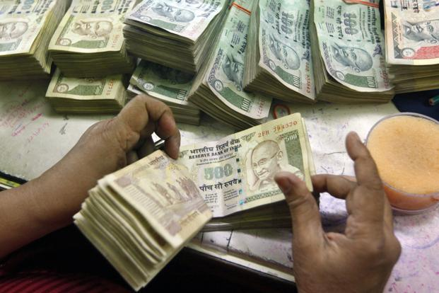 The statement was made in the Rajya Sabha even as people queued up at banks to deposit old high value notes and withdraw new cash. Photo: Reuters