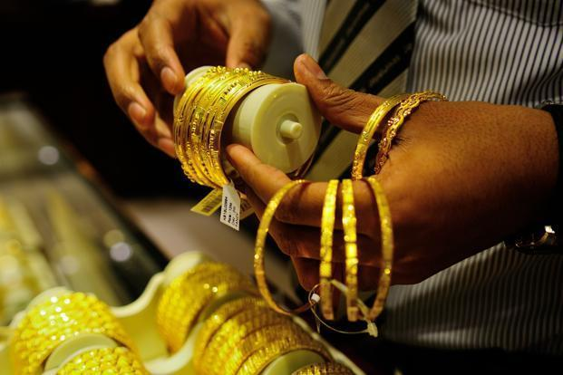 Standard gold (99.5 purity) fell by Rs95 to close at Rs28,905 per 10 grams from Monday's closing level of Rs29,000. Photo: Mint