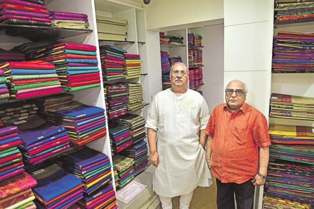 Ashok Dhawan (left), former president of Banarasi Vastra Udyog Sangh, with Jagdish Shah of Jagdish Das & Co., one of the biggest wholesalers of Banarasi saris in Varanasi. Photo: Priyanka Parashar/Mint