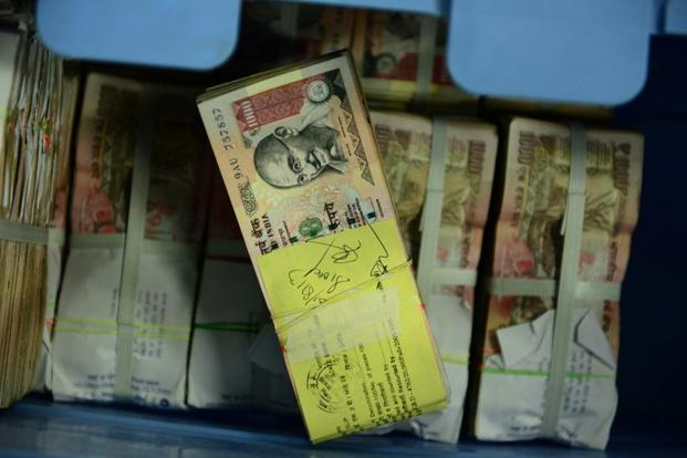 Cash in old as well as new currency was found in the raids. Photo: Mint