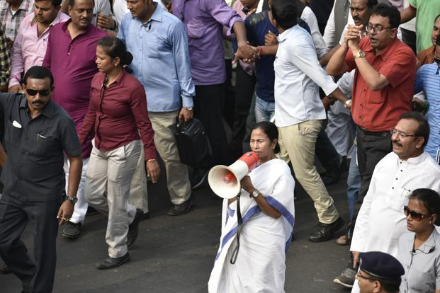 West Bengal chief minister and TMC leader Mamata Banerjee (centre) shouts slogans as she leads a protest march against the government's decision to withdraw high denomination notes from circulation in Kolkata on Monday. Photo: Indranil Bhoumik/Mint