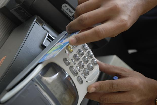 Traffic cops have already started the use of swipe machines for the convenience of commuters. Photo: Mint