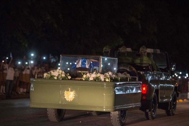 A military car tows a trailer with the flag draped chest containing the remains of former president of Cuba Fidel Castro during the journey across the country for his burial on November 30 in CienFuego. Photo: AFP