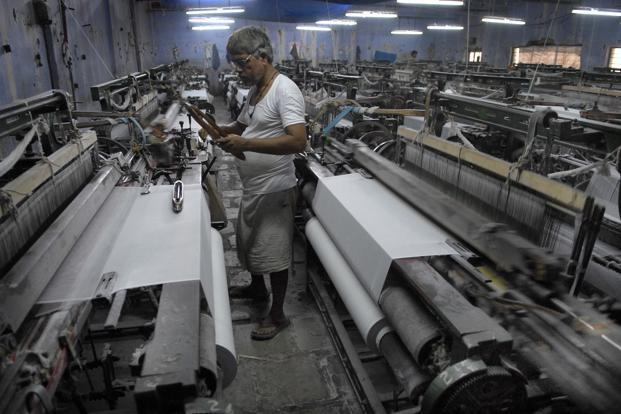 Many powerloom owners had procured huge quantity of cloth, but those who gave orders were now demanding that the price be reduced by Rs3 a meter. Photo: Mint