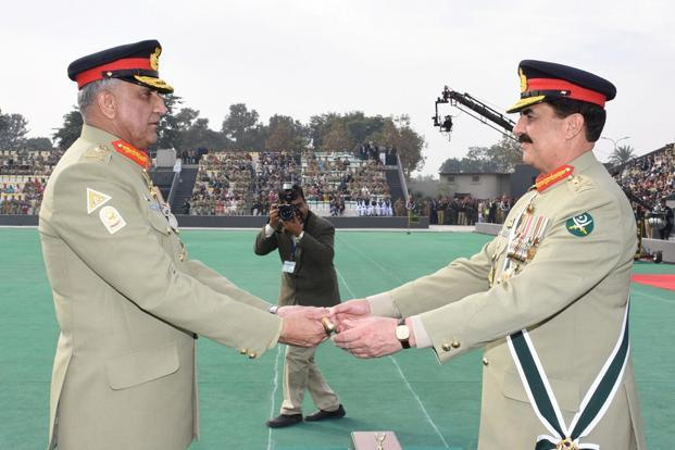Pakistan's outgoing army chief general Raheel Sharif (right) hands over a ceremonial baton to his successor general Qamar Javed Bajwa during the Change of Command ceremony in Rawalpindi on Tuesday.