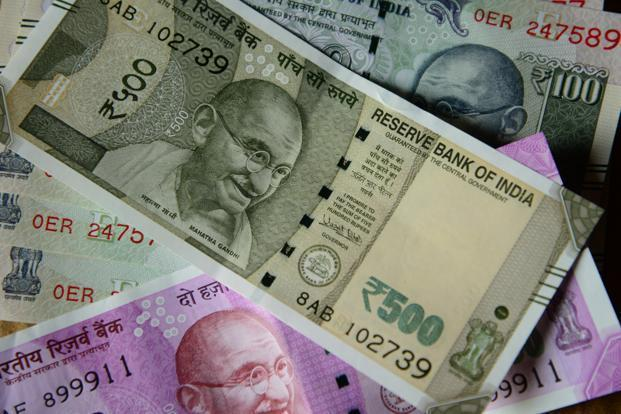 At 2pm, the rupee was trading at 68.28 a dollar, up 0.12% from its previous close of 68.35. The home currency opened at 68.29 against the US dollar. So far this year, it has fallen 3.1%. Photo: Mint