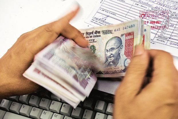 Companies can now raise funds in the local bond market at cheaper costs, after the demonetisation sparked a flood of money into banks that have ploughed it into debt securities. Photo: AFP