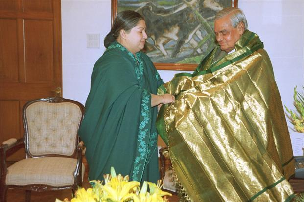 Tamil Nadu chief Minister J. Jayalalithaa presents a shawl to the then Prime Minister Atal Behari Vajpayee at his residence in New Delhi on 5 June 2001. HT