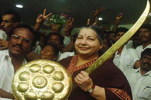Jayalalithaa holds a sword at the AIADMK party office in Chennai on 12 March 2009. PTI