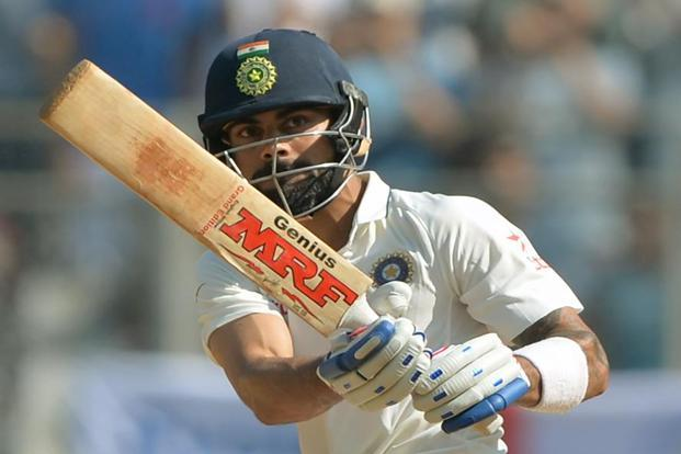 Virat Kohli plays a shot on the fourth day of the fourth Test cricket match between India and England at the Wankhede stadium in Mumbai on Sunday. Photo: AFP
