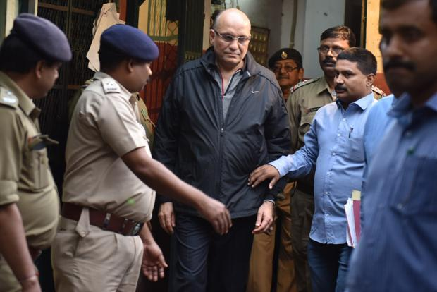 On Sunday, with the permission of the court, CID added another charge against Pawan Ruia (centre)—that of mischievously setting fire to destroy a property. Photo: Indranil Bhoumik/Mint