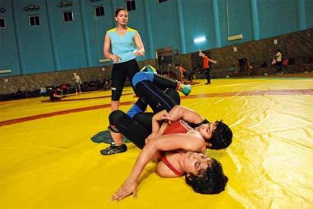 Vinesh (in red) and Babita trains for the 2014 Asian Games under Geeta Phogat's watch. Photo: Ashok Dutta/Hindustan Times