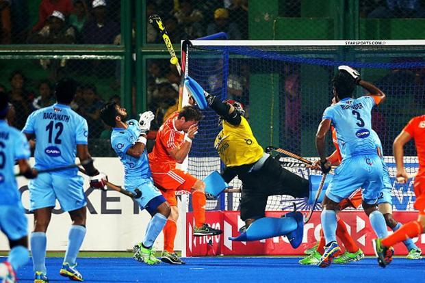 The team is overly-reliant on skipper P.R. Sreejesh (in yellow) to carry out goal-keeping duties. Photo: Ian MacNicol/Getty Images
