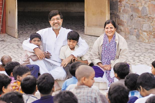 A file photo of child rights activist Kailash Satyarthi (left) with children. Photo: Joerg Boethling/Alamy Live News