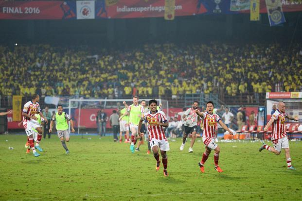 Atletico de Kolkata players celebrate after winning the Indian Super League (ISL) final football match between Kerala Blasters FC and Atletico de Kolkata at the Jawahar Lal Nehru Stadium in Kochi on Sunday. Photo: AFP