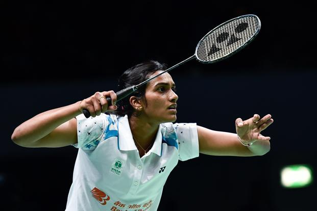 P.V. Sindhu plays a shot during her women's singles match on the third day of the BWF Dubai World Superseries Finals at the Hamdan Sports Complex on 16 December in Dubai. Photo: AFP