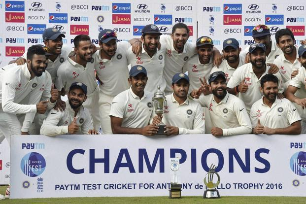 Indian cricket team poses for a group photograph with the winning trophy after registering test series win against England, at MAC Stadium, in Chennai on Tuesday. Photo: PTI
