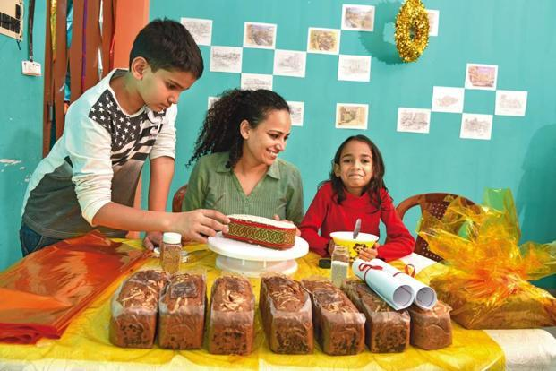 Brunnel Arathoon with her children, decorating her Armenian Christmas cakes.