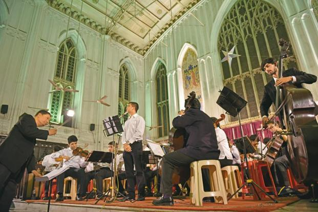Abraham Mazumder (left) conducting the KMA orchestra at St Paul's Cathedral. Photographs by Indranil Bhoumik/Mint